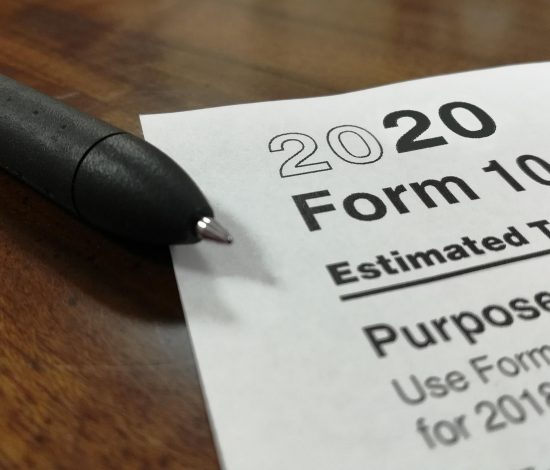 pen on top of a 2020 Form 1040 tax document