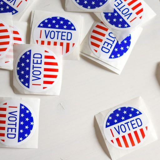 """""""I Voted"""" stickers on a white surface"""