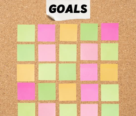 "Image: Bulletin board, ""Goals"", blank sticky notes"